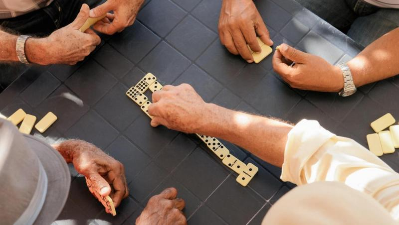 hands showing they're playing dominos